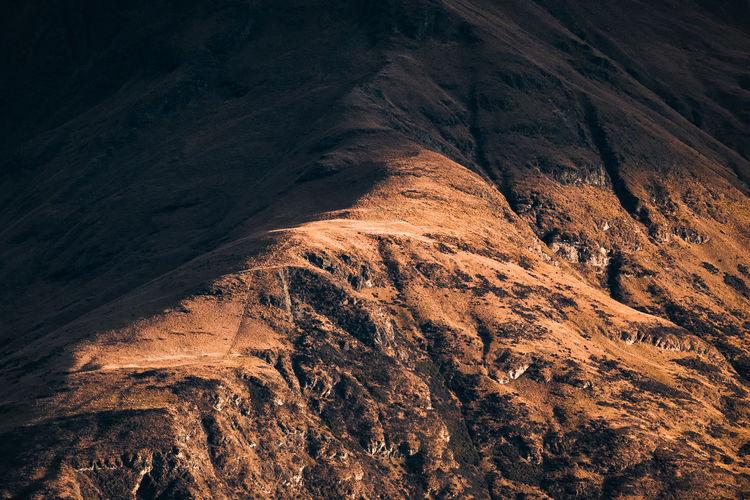 Shadow cast on the edge of a mountain ridge.