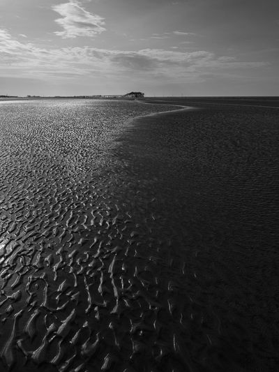 Surface level of beach against sky
