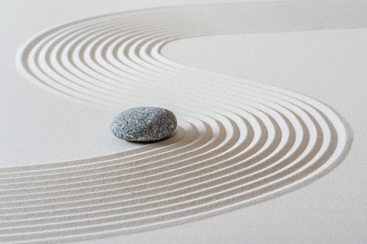 High angle view of stones on white surface