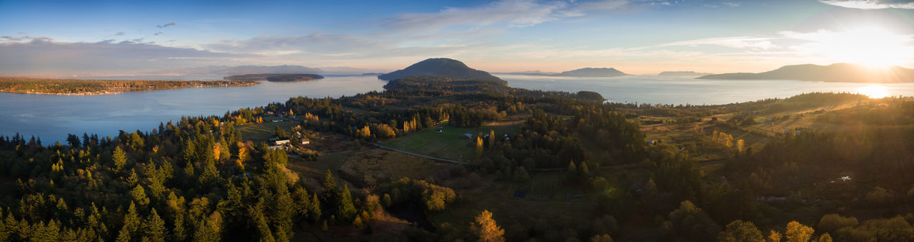 Day is Done, Gone the Sun...Almost. Drone shot of Lummi Island, Washington. Autumn has arrived and the sun sets in a different place. Drone  Lummi Island Pacific Northwest  Panorama Puget Sound Salish Sea Washington Washington State Aerial Aerial View Beauty In Nature Cloud - Sky Drone Photography Landscape Mountain Nature No People Ocean Outdoors Scenics Sky Sun Sunlight Sunset Tree