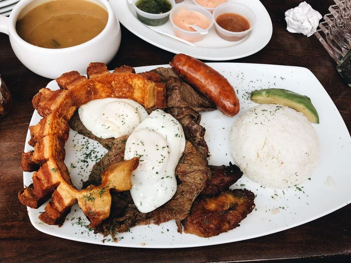 Bandeja Paisa Bandeja Paisa Colombian Food Food And Drink Food Freshness Plate Ready-to-eat Indoors  Healthy Eating Still Life High Angle View No People Meal Close-up Fried