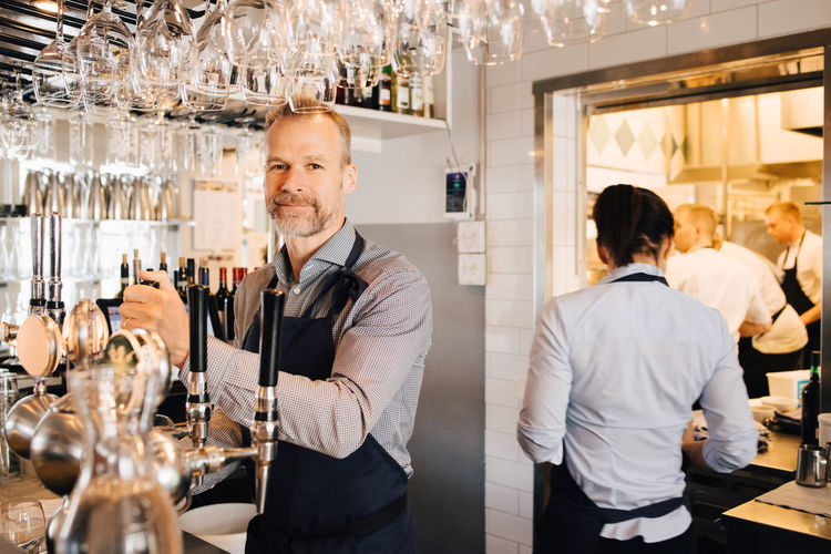 Portrait of people standing in restaurant