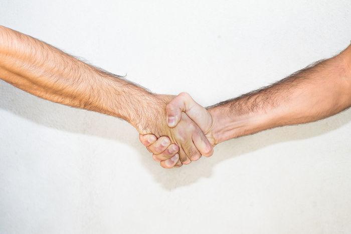 A handshake between two people. Business Meeting Teamwork Acquaintance Arm Deal Decision Forearm Friend Friendship Hand Handshake Meet Partner Partners Partnership People Team Trust First Eyeem Photo