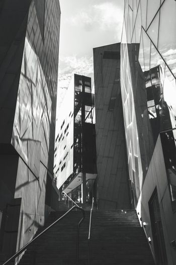 Low angle view of office buildings against sky