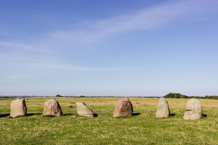 Menhirs on field against clear sky