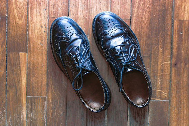 Classic vintage shoes on wood. Shoe Flooring Pair Entrance Accessory Vintage Wood Floor Fashion Shoes Footwear Brown Casual Clothing Classic Lace Rubber Leather Comfort Style Retro Man Two Black Clothing Menswear