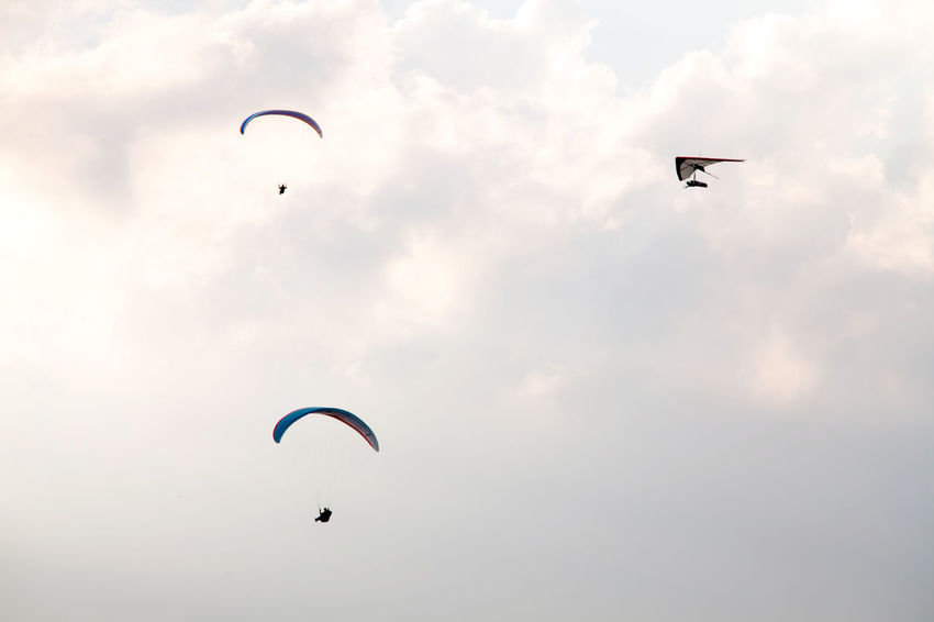 Adventure Adventure Sports Air Beauty In Nature Day Extreme Sports Flying Flying In The Sky Gliding Lifestyles Mid-air Nature Outdoors Parachute Paragliding People Radical Sport Scenics Silhouette Sky Sport