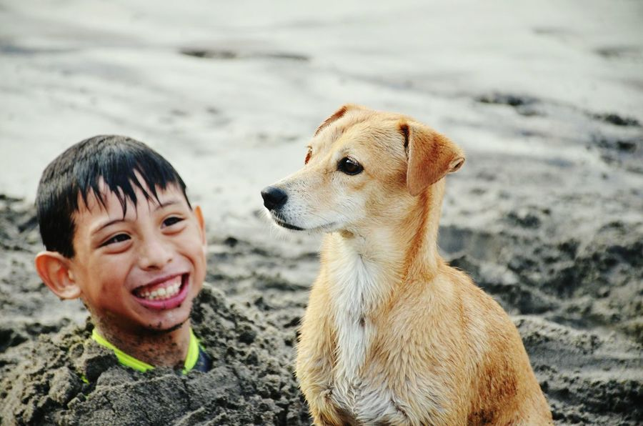 Child Smiling Child Watching Dog Boy Smiling Dog Watching Children_collection Dog Watching Sunset Dog At The Beach Beauty In Nature Animals And Children Day Sand The Week On EyeEm