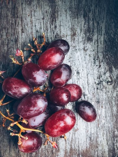 Grape fruit over vintage wooden background Food Food And Drink Healthy Eating Fruit Wellbeing Red Freshness Directly Above Close-up No People High Angle View Still Life Table Indoors  Wood - Material Berry Fruit Cherry Organic Group Of Objects Day