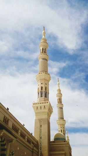 Low angle view of al-masjid an-nabawi against sky