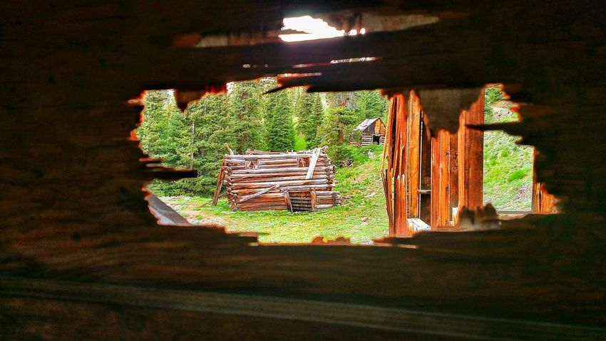 Perspective Photography Ghost Town Abandoned Places Log Cabin Mining History Of America Country Life Peeking Through Peeking Out Peek Country Photography Coloradophotographer Abstract Photography Abandoned San Juan Mountains Colorado_collection