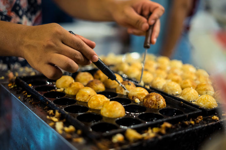 Cropped hands preparing food