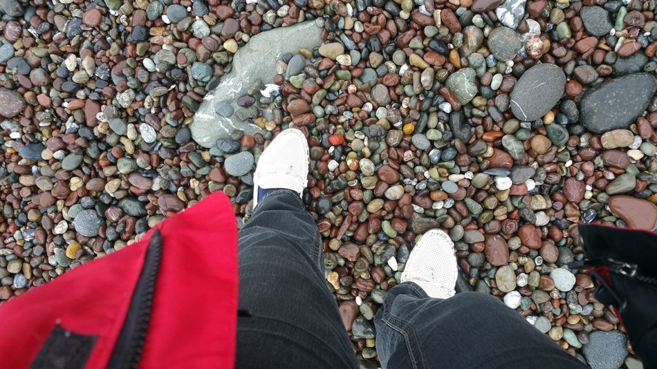 Walking Beach Pebbles Contemplating Copy Space High Angle View Meditation Sand Beach Stone Red Green Natural Color Natural Light No Edit Red Coat Jacket Shoes Low Section Human Leg Pebble One Person Human Body Part Abundance Shoe EyeEm Ready