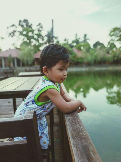 Cute boy looking at lake