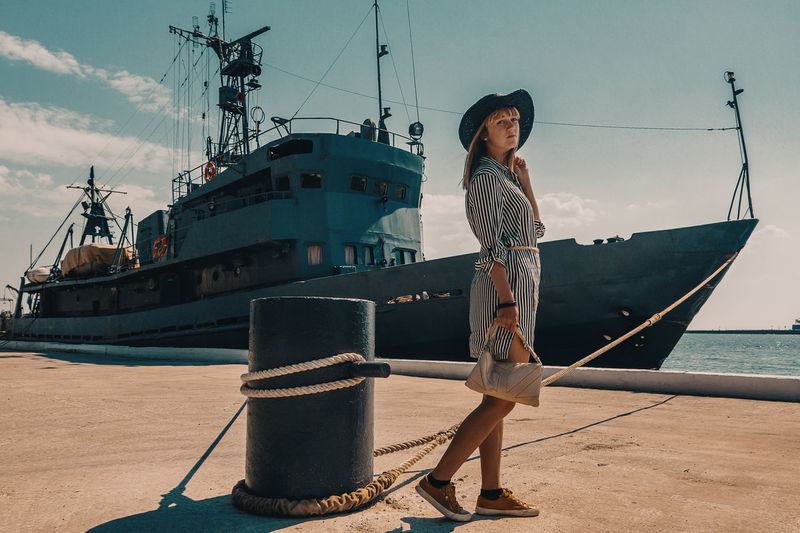 Traveling Home For The Holidays Sea Outdoors One Person Full Length People Adults Only Young Adult Standing Finding New Frontiers One Woman Only Woman Ship Transportation Travel Posing Casual Clothing Sky Beauty Kaliningrad Baltic Sea the ship and the woman