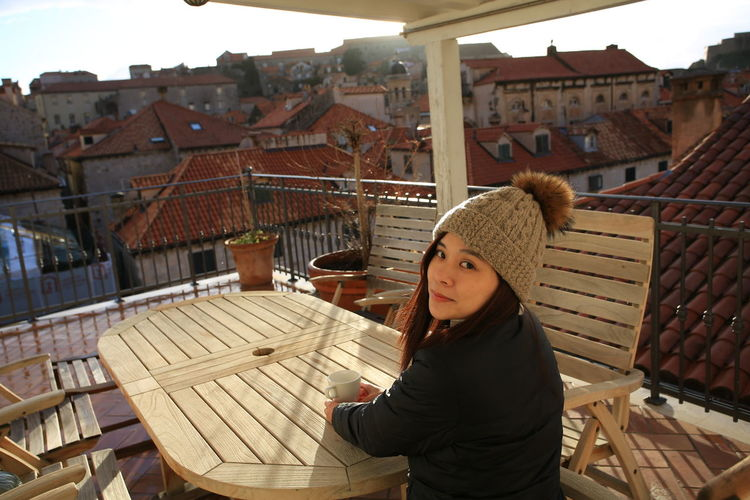 Dubrovnik Croatia Sunset Bright Rooftop Europe Travel Destinations Traveling Girl Woman Portrait Visiting Explore Morning Tourist Casual Clothing Lifestyles Balcony Balcony View Travel Photography Beautiful Woman Asian  Trip Coffee Time Good Morning
