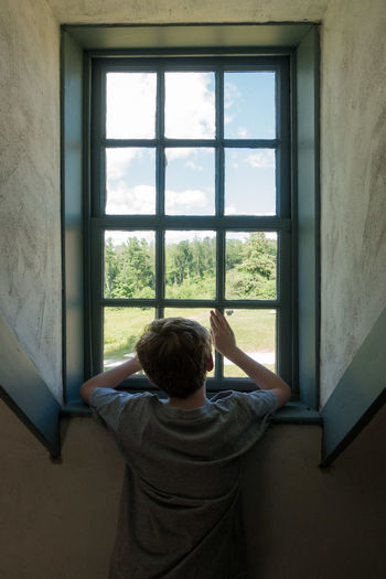 Boy Boys Childhood Day Human Hand Indoors  Leisure Activity Lifestyles Looking Through Window One Person People Real People Standing Window