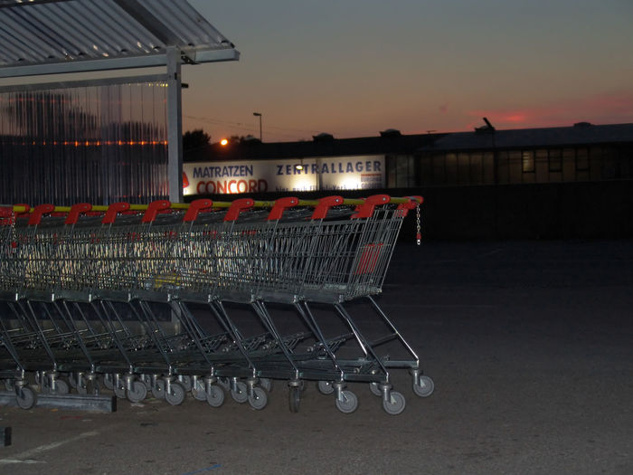 Absence Architecture Building Building Exterior Built Structure City Consumerism Empty Hardlight Illuminated Lighting Equipment Nature No People Outdoors Retail  Shopping Shopping Cart Sky Street Sunset Trolley