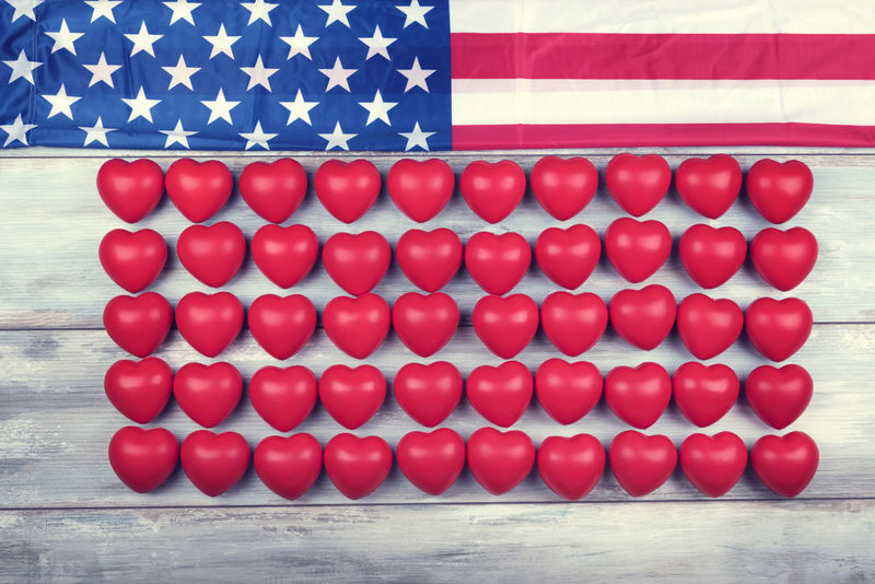 American flag and fifty red hearts in line 4th Of July American Flag Celebration Freedom Happy Holiday Liberty Lines Memorial National Shape USA Backgrounds Day Fifty Hearts Independance No People Red Row Stars State Striped Symbol Wooden