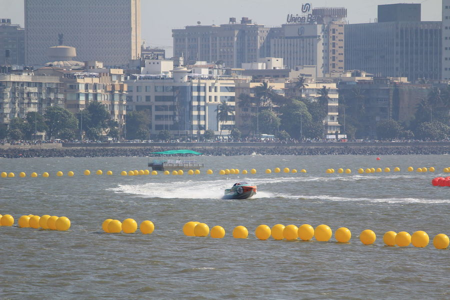 City Skyscraper Cityscape Urban Skyline Bridge - Man Made Structure Outdoors Water Sports Splash Boat Race  Power Boats Boats Race Morning Mumbai Modern Sports Race Boat Motion Speed Cityscape Architecture No People Floating On Water Day Water