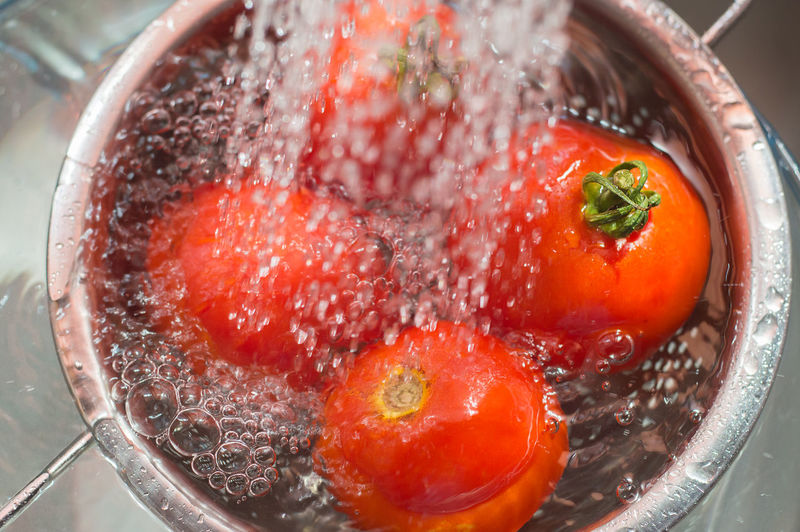 High angle view of tomatoes in strainer over sink