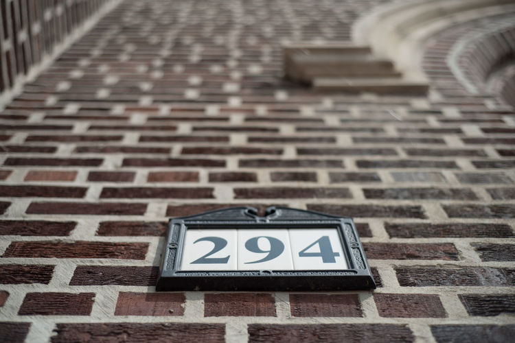 Architecture Brick Built Structure Capital Letter Close-up Communication Day Design Flooring Focus On Foreground High Angle View Indoors  Information No People Number Pattern Sign Text Wall Western Script