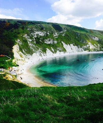Cove Sea Seaside_collection Seaside View England By The Sea England Nature Sky Cloud - Sky Beauty In Nature Water Grass Day Outdoors Scenics Landscape No People Green Color Tranquility Beach Horizon Over Water