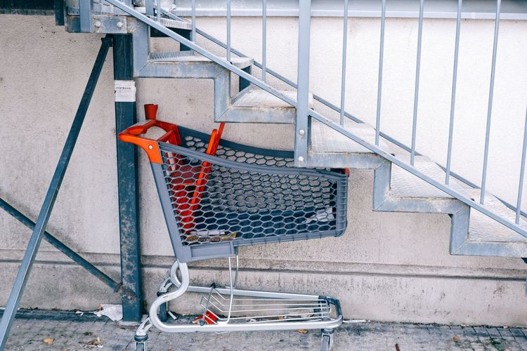 Shopping trolley under the stairs