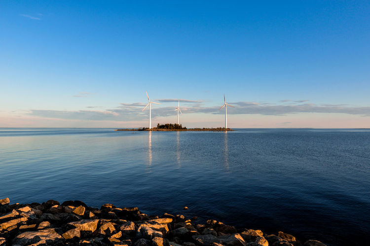 Blue landscape Bay Of Bothnia Beautiful EyeEm Best Shots EyeEm Nature Lover Finland Reflection Alternative Energy Beach Beauty In Nature Blue Horizon Over Water Landscape Nature Nature_collection No People Outdoors Photography Rock Sea Sky Sunset Tranquil Scene Tranquility Water Wind Turbine