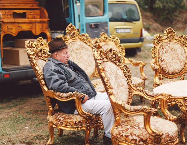 Market Fleamarket Flea Markets Armchair Armchairs 43 Golden Moments Negreni Bihor Cluj One Person Sitting Resting Traditional Seller Old-fashioned Old Furnitures People And Places Snap a Stranger Art Is Everywhere This Is Aging