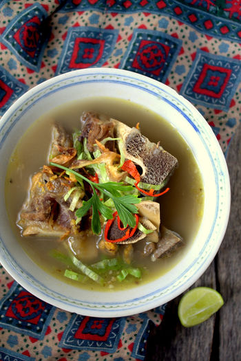 Sup tulang or beef bone soups are known to be flavoursome with generous amount of bumbu spice mixture. Famous food in South East Asia Asian Street Bowl Bridge Composition Culture Directly Above Food And Drink Healthy Eating Healthy Lifestyle Indonesian Food Malaysian Food Malaysian Food And Drink Plate Soup Still Life Sup Tulang Surabaya Bonex Top Perspective