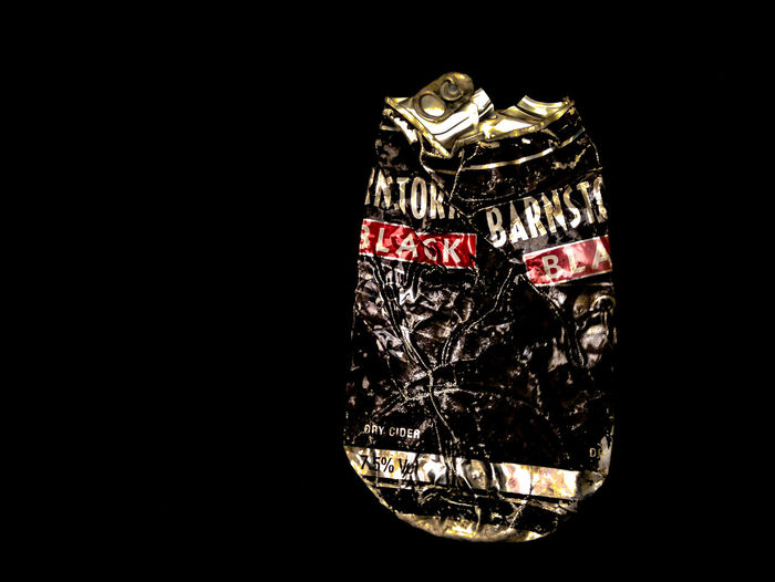 barnstormer Crumpled Aluminium Can Black Background Business Close-up Communication Copy Space Cut Out Drink Food And Drink Gold Colored Indoors  Luxury Metal No People Single Object Still Life Studio Shot Text Transparent Wealth Western Script