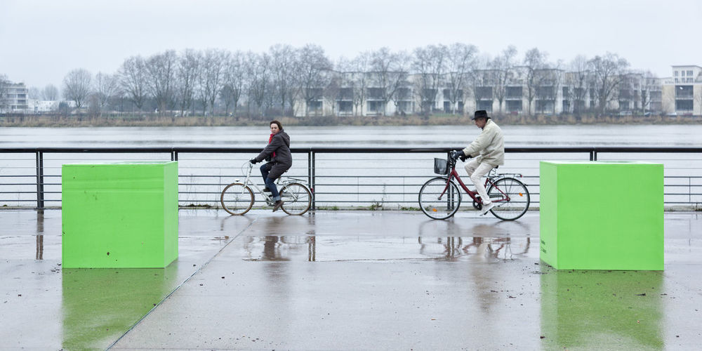 Woman riding bicycle on railing