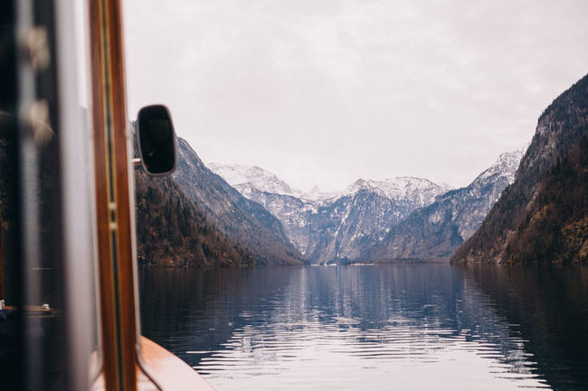 View of Königssee and Bavarian Alps including Watzmann from a boat on Königssee, Bavaria, Germany. Bavaria Horizontal Schönau Am Königsee Travel Photography Winter Alps Beauty In Nature Boat Cold Temperature Day Europe Germany Königsee Lake Landmark Mountain Mountain Range Nature No People Outdoors Scenics Sky Snow Water Winter