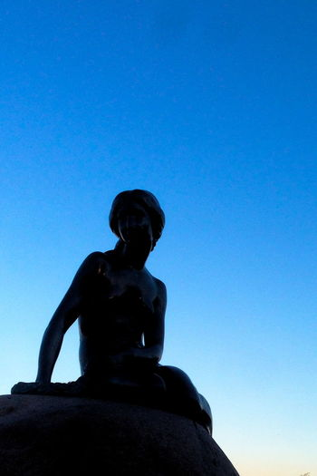 Back in town Art Art And Craft Blue Clear Sky Creativity Day Human Representation Mermaid Little Mermaid  Outdoors Sculpture Silhouette Sky Statue Travel Destinations