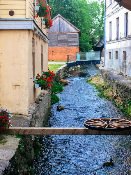 Aleksupite river winding through town, Kuldiga. Latvia Architecture Building Exterior Built Structure Canal Day Flowing Flowing Water House Kuldiga Latvia Old Outdoors Plant Residential Structure River Roof Streetphotography Summer Summertime Wall Water Wood Wood - Material