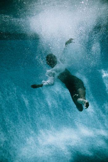 Dancer swimming in pool
