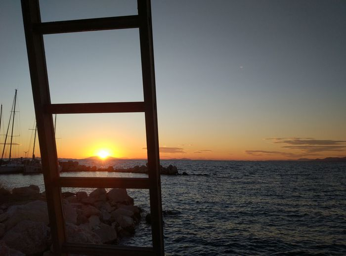 the frame Sunset Silhouettes Sunset_collection Beach Beauty In Nature Clear Sky Close-up Day Horizon Over Water Nature No People Orange Color Outdoors Scenics Sea Silhouette Sky Sun Sunlight Sunset Tranquil Scene Tranquility Water EyeEmNewHere