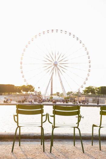 Ferris Wheel Travel Destinations City Clear Sky Outdoors Amusement Park Ride Paris, France  Tuileries Garden Park Paris Grande Roue De Paris Chairs Travel Sunset Arts Culture And Entertainment Golden Hour France