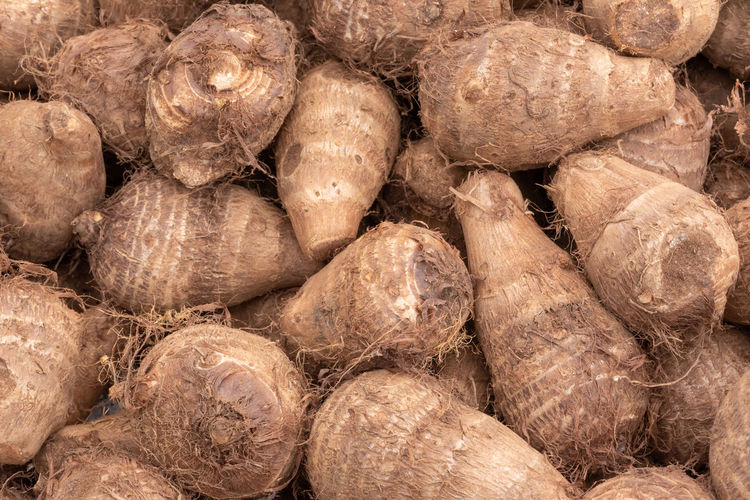 Taro vegetable Full Frame Backgrounds Food And Drink Food Large Group Of Objects Freshness Abundance Healthy Eating Wellbeing No People Brown Close-up Stack Raw Food Vegetable Still Life Heap Textured  Retail  Outdoors Vegetarian Food Taro