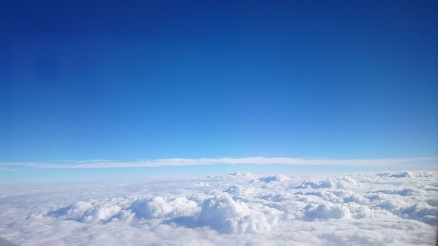 Scenic View Of Cloudscape Against Clear Blue Sky