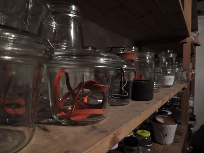 Arrangement Bottle Bottles Cellar Close-up Drink Food And Drink Glass - Material In A Row Indoors  Jar Jars  Large Group Of Objects Preserving Preserving Memories Rubber Rubberband Shelf Shelves Still Life Storage Storage Room Store Transparent Variation