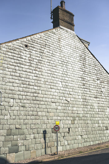 30 Pattern, Texture, Shape And Form Architecture Brick Wall Building Exterior City House Newtopographics No People Road Road Sign Sign Space For Text
