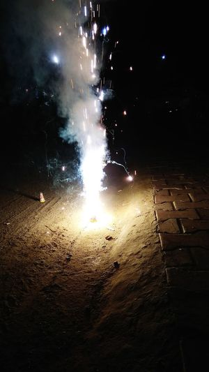 Firework display on street at night
