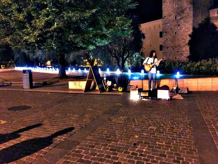 Tree Night Illuminated Real People Outdoors Architecture Built Structure Leisure Activity Nature Lifestyles Men Young Adult Sky People Streetmusician Borja Catanes