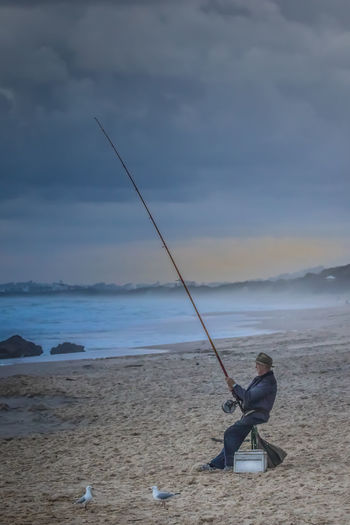 The Fisherman Angler Atmospheric Mood Australia & Travel Australian Life Beach Beach Photography Dusk Evening Fisherman Fishing Leisure Activity Leisure Time Life Is A Beach Lifestyles Moody Old Man Pete Evans Photography Relaxing The Sea Tranquil Scene