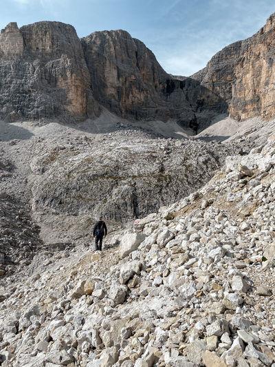 Hiker on the roda de valun, sella group, dolomites, south tyrol, italy