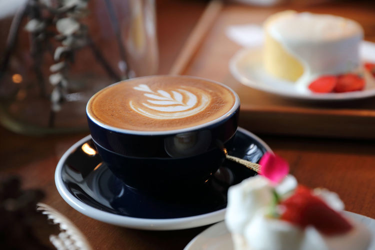 Food And Drink Drink Refreshment Cup Coffee Cup Coffee - Drink Mug Coffee Frothy Drink Still Life Freshness Hot Drink Saucer Table Indoors  Food Cappuccino Froth Art Crockery No People Latte Non-alcoholic Beverage