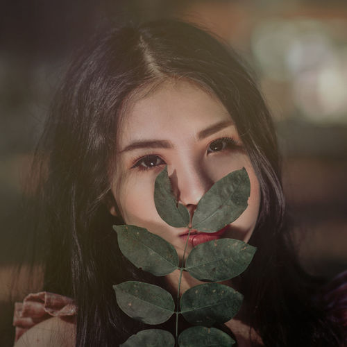In some corners of Viet Nam Beautiful Woman Childhood Close-up Day Focus On Foreground Front View Headshot Heart Shape Human Eye Leaf Lifestyles Looking At Camera Love One Person Outdoors People Portrait Real People Young Adult Young Women This Is Natural Beauty
