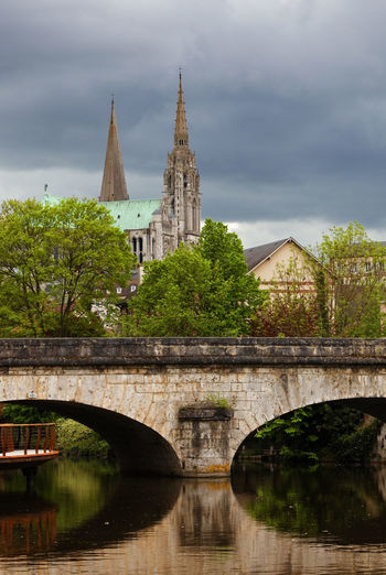 Chartres Cathedral and a bridge over Eure river. Cathedral Chartres Chartres Cathedral Chartres, France City Cityscape Eure River TOWNSCAPE Travel Arch Architecture Bridge - Man Made Structure Building Exterior Built Structure Cloud - Sky Eure Landmark Nature Outdoors River Tourism Town Water